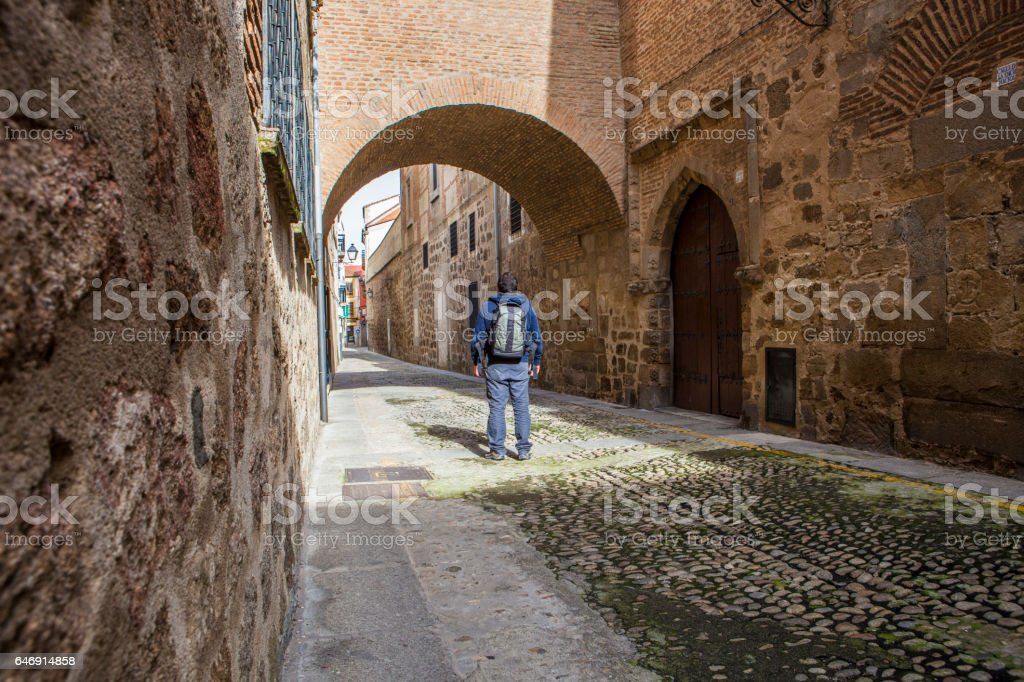 Visitor walking by Encarnacion Street at medieval old town of Plasencia stock photo