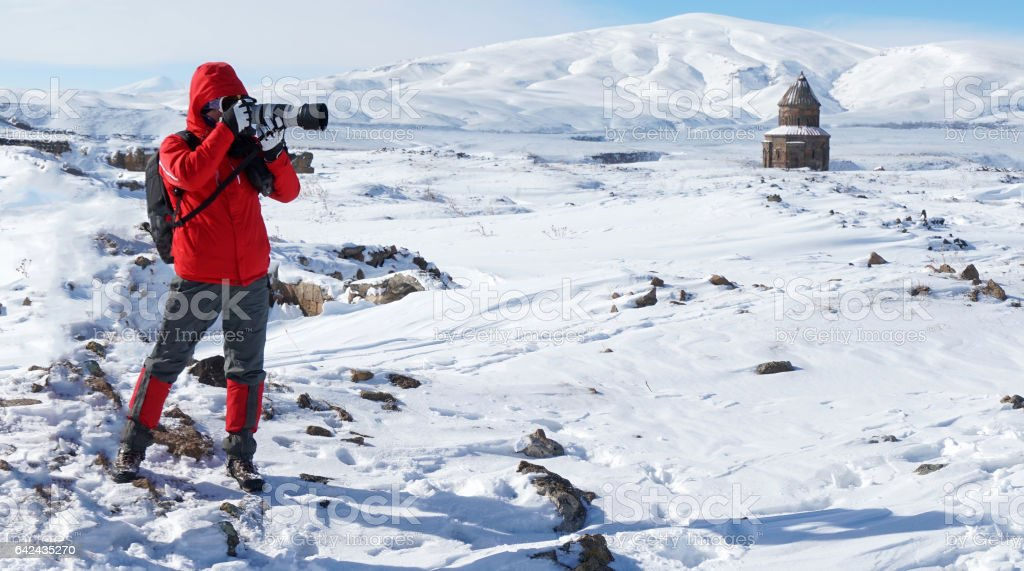 A visitor who is taking photos in the historic spot in winter stock photo