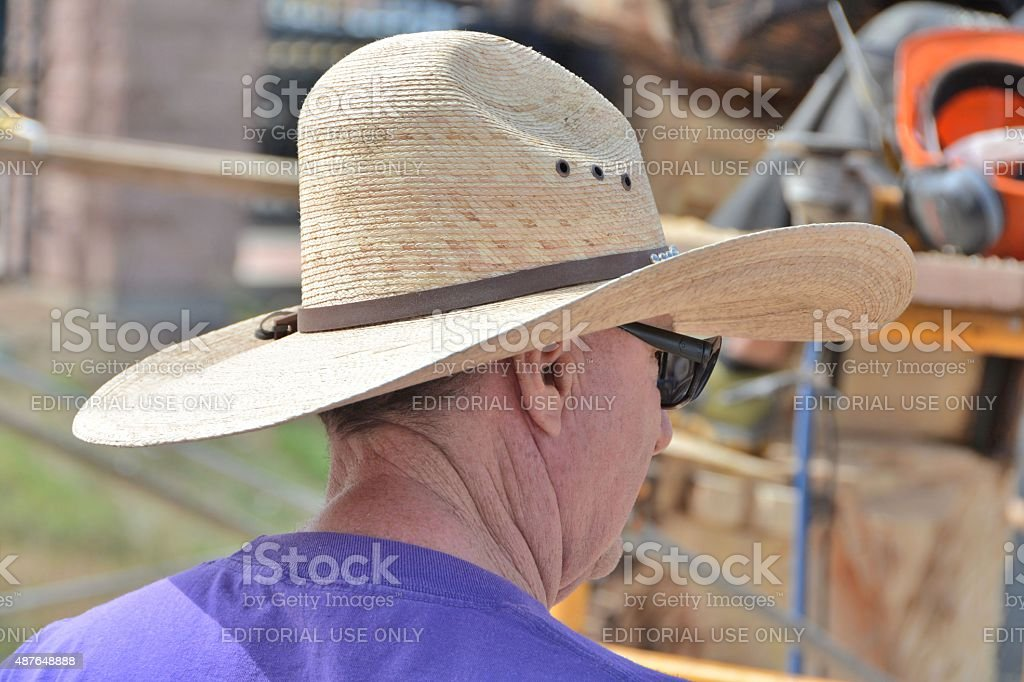 Visitor with Big Straw Hat. stock photo
