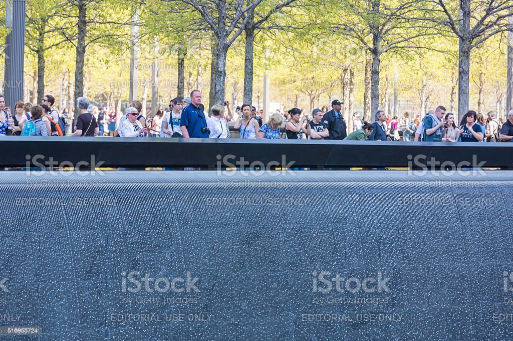 Visitors at 9/11 Memorial plaza stock photo