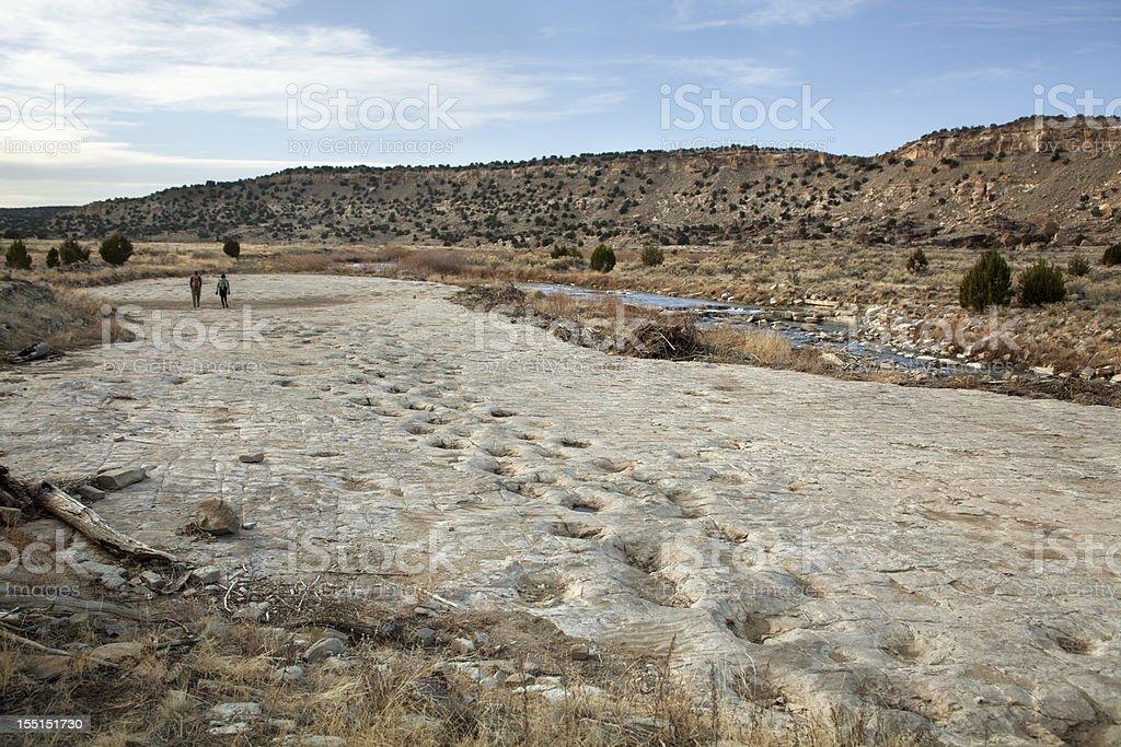 Visitors at Jurassic sauropod dinosaur tracksite Purgatoire River Colorado stock photo