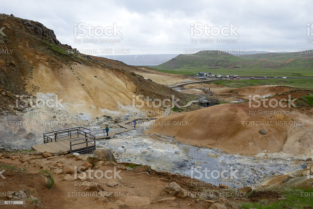 Visitors at Seltun Hot Springs in Iceland stock photo