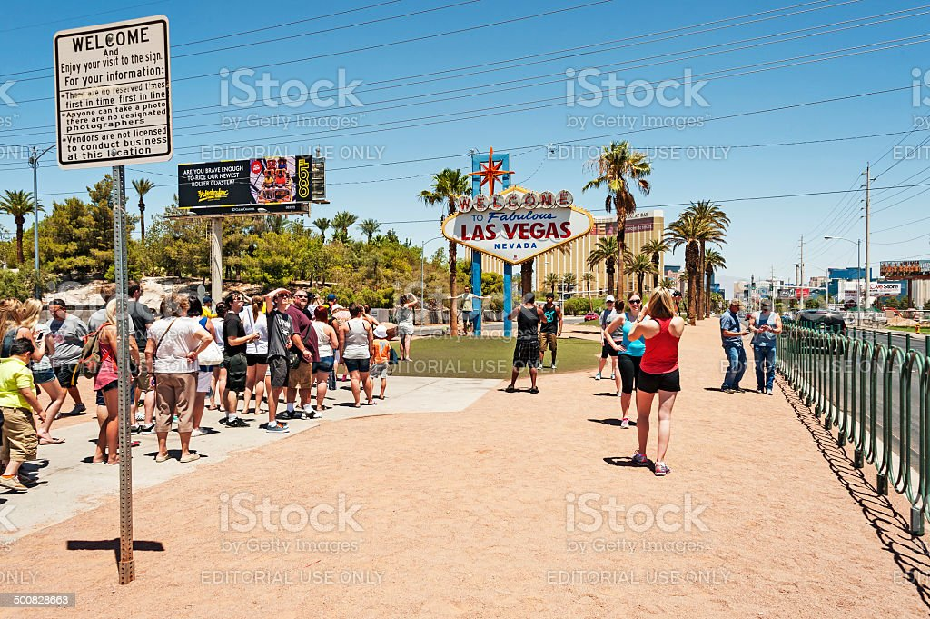 Visitors at Welcome Sign royalty-free stock photo