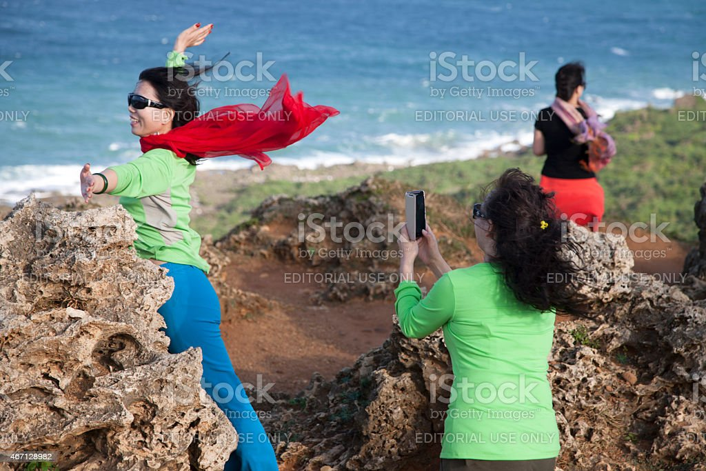 Visitors enjoy the Eastern Taiwanese coastline, Taitung, Taiwan stock photo