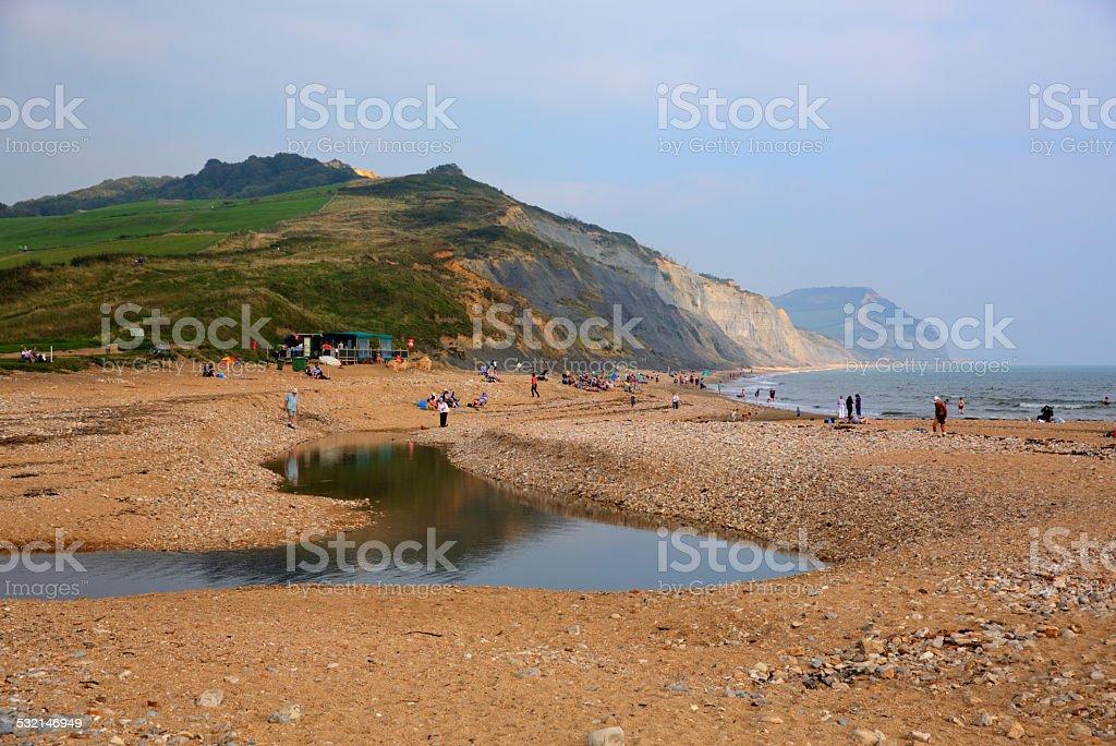 Visitors enjoying late summer sunshine Charmouth Dorset stock photo