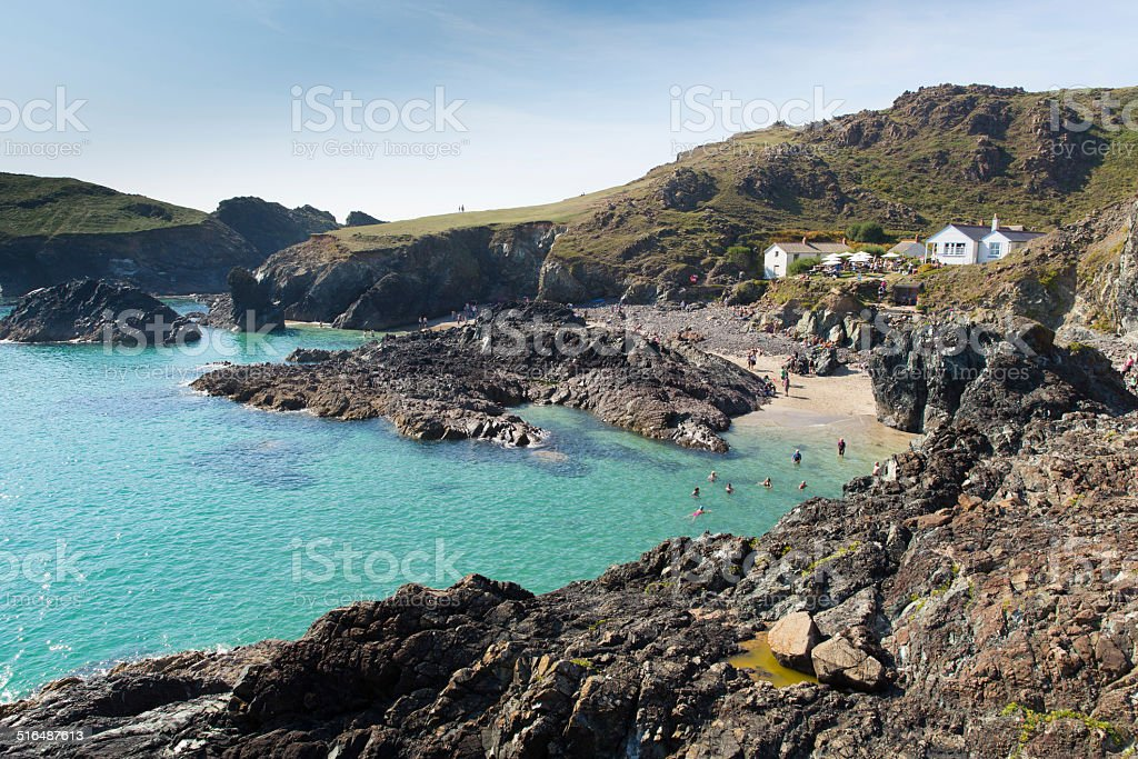 Visitors enjoying late summer sunshine Kynance Cove The Lizard  Cornwall stock photo