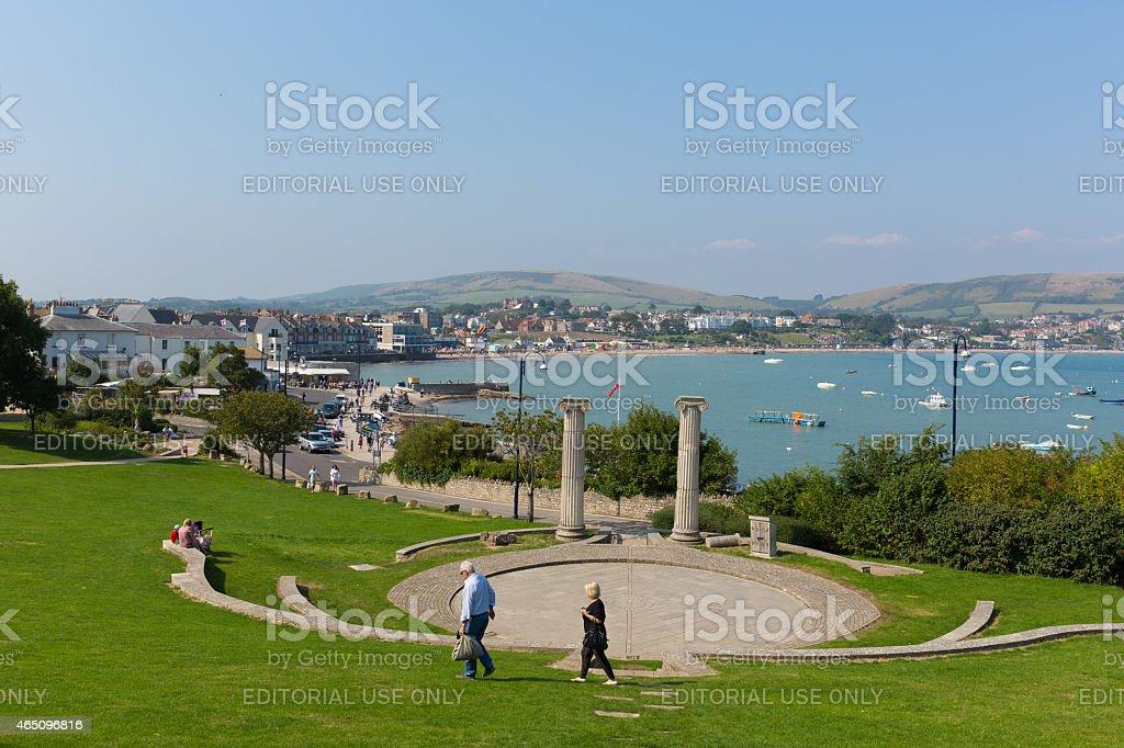Visitors enjoying summer sunshine Swanage beach Dorset England UK stock photo