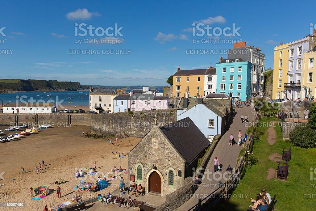 Visitors enjoying summer sunshine Tenby beach South Wales stock photo