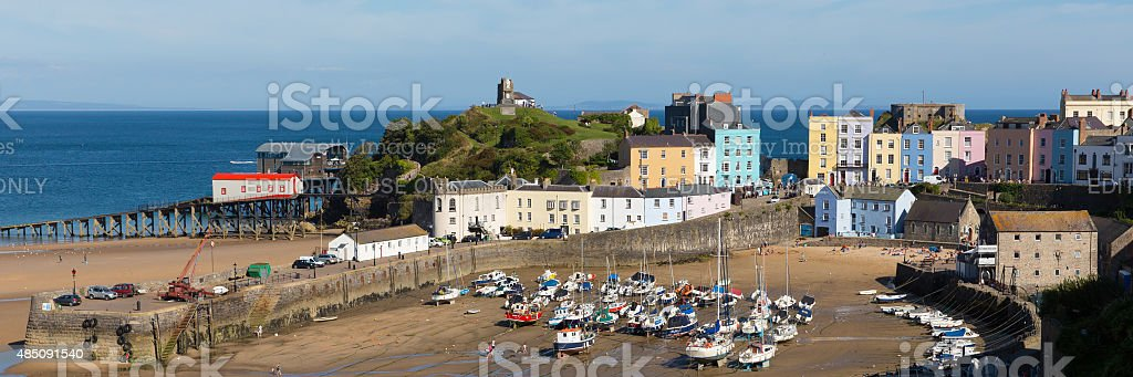 Visitors enjoying summer weather and sun Tenby harbour South Wales stock photo