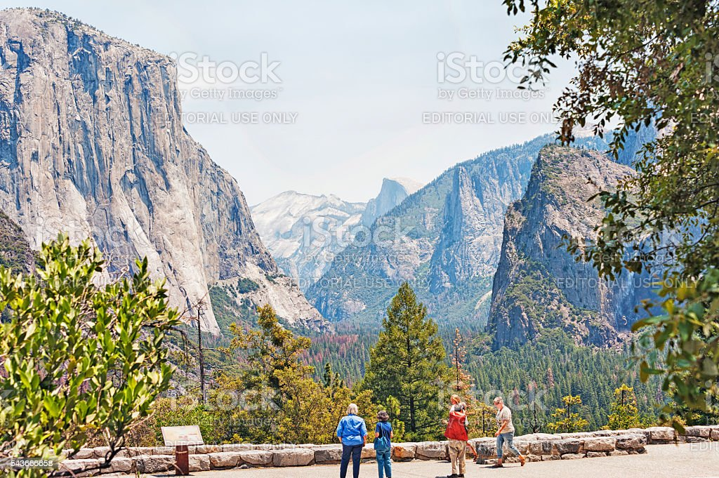 Visitors enjoying view of Yosemite Valley and Icons stock photo