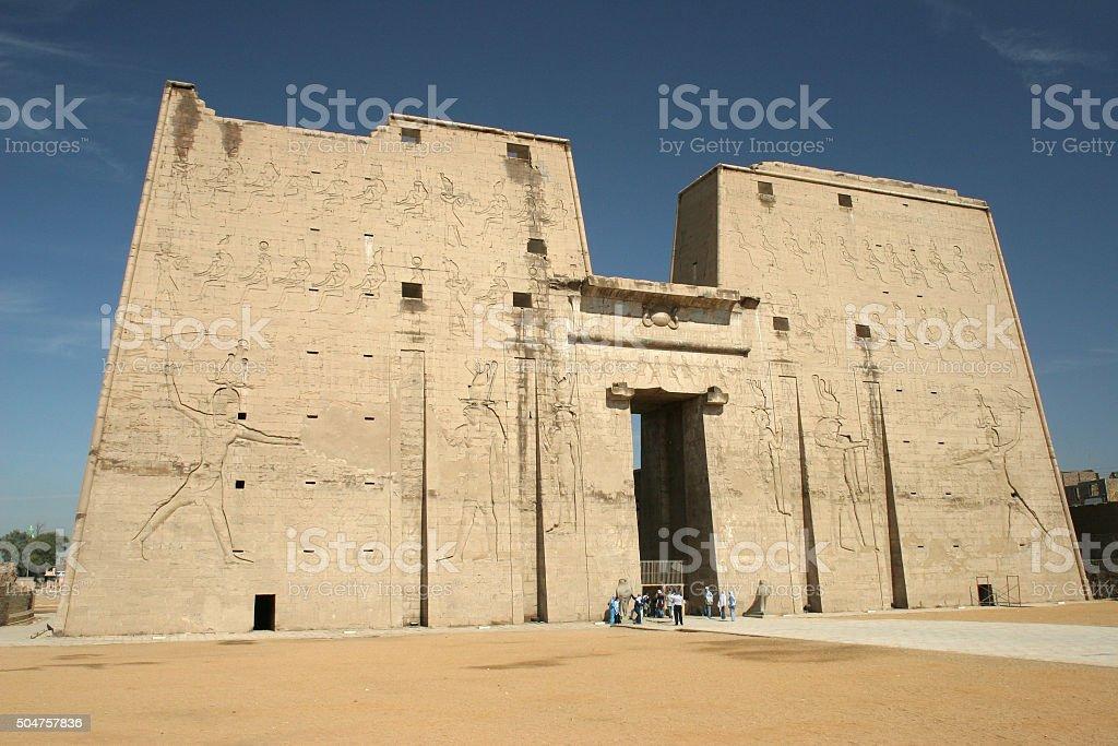 Visitors enter the massive Temple of Edfu Egypt stock photo