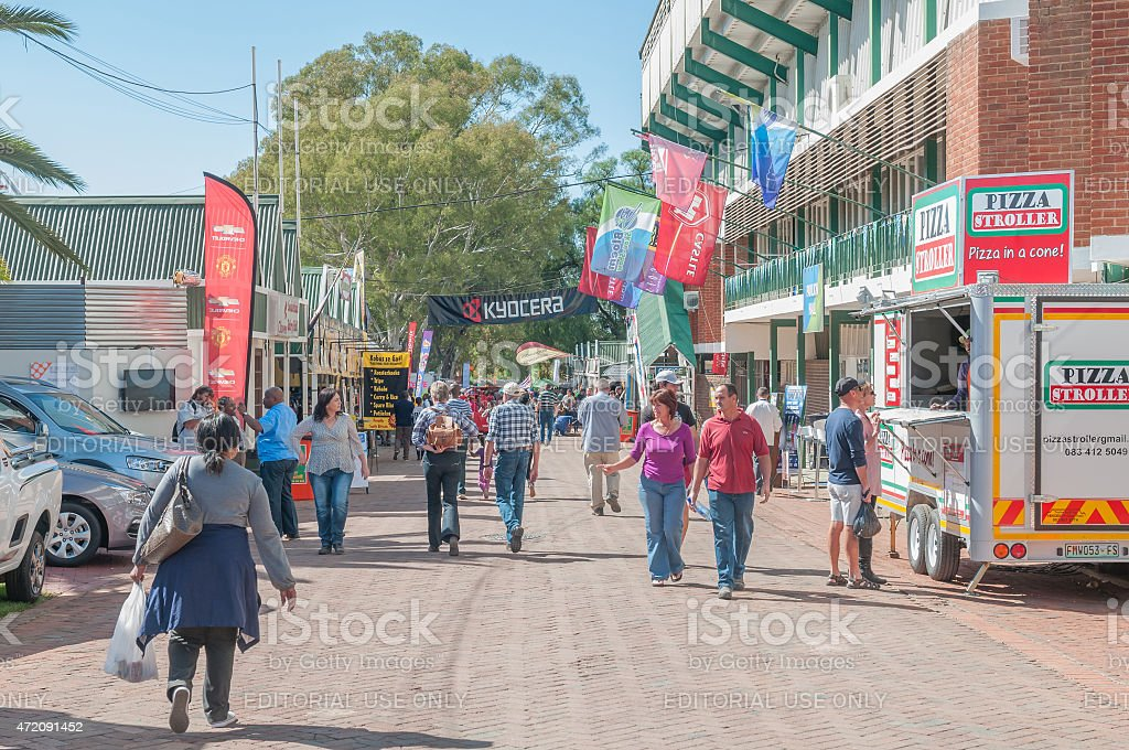 Visitors in a street scene at the Bloem Show stock photo