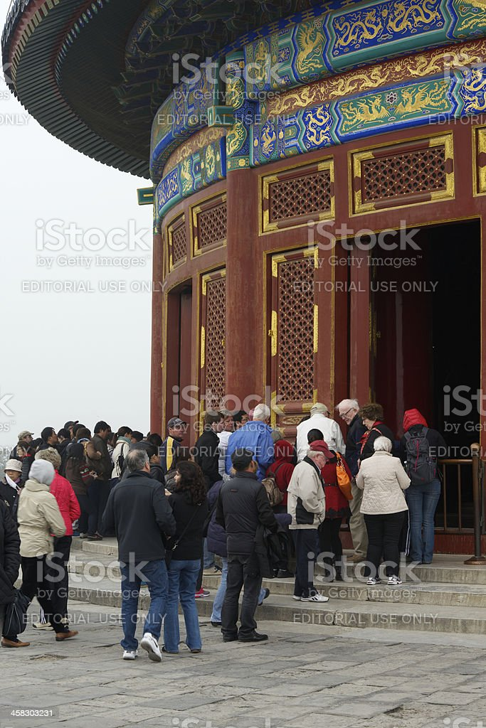 Visitors in Temple of Heaven on cold and hazy day royalty-free stock photo