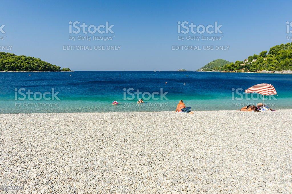 Visitors on Panormos beach stock photo