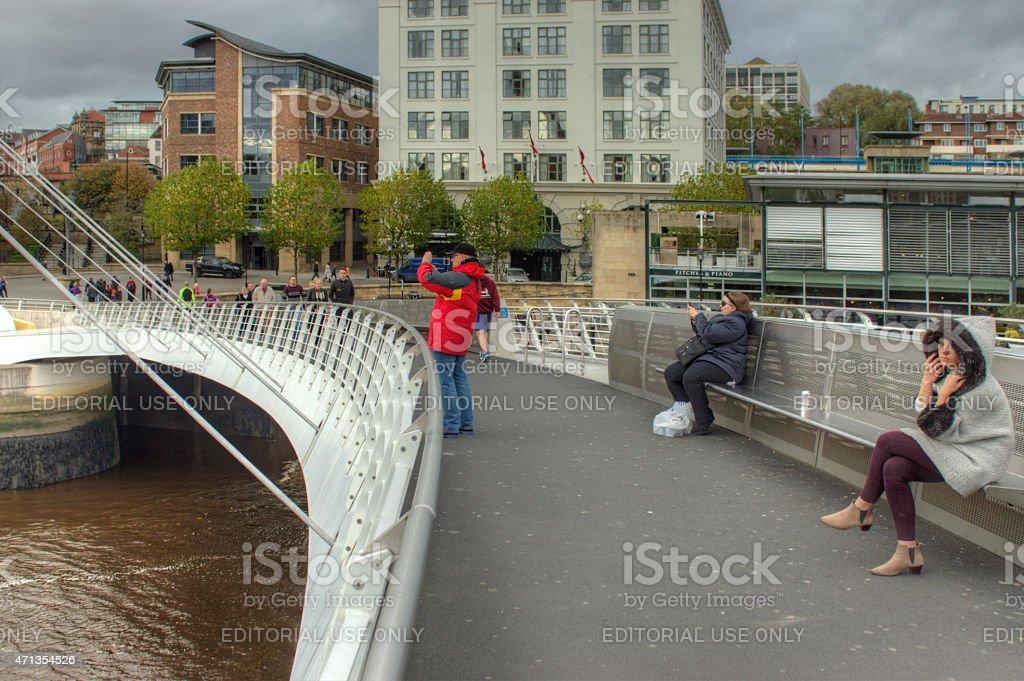 Visitors on the Millenium Bridge stock photo