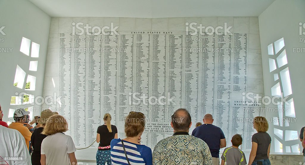 Visitors to the USS Arizona memorial in Pearl Harbor stock photo
