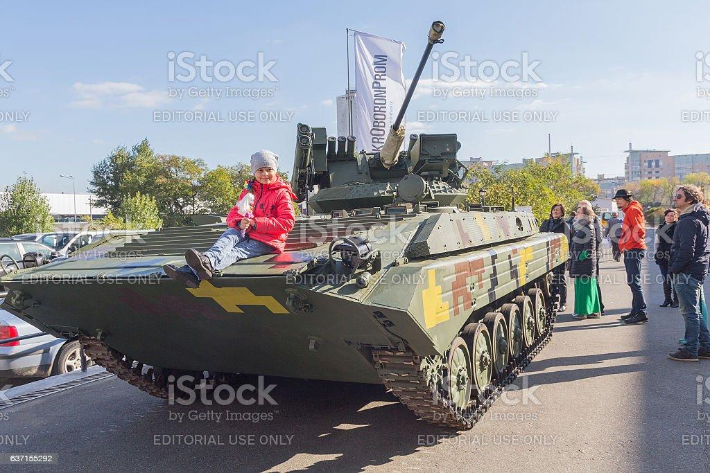 Visitors view models of weapons. Kiev, Ukraine stock photo