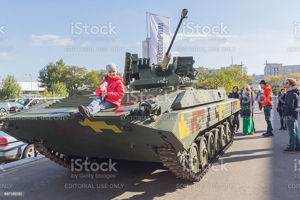 Visitors view models of weapons. Kiev, Ukraine stock photo