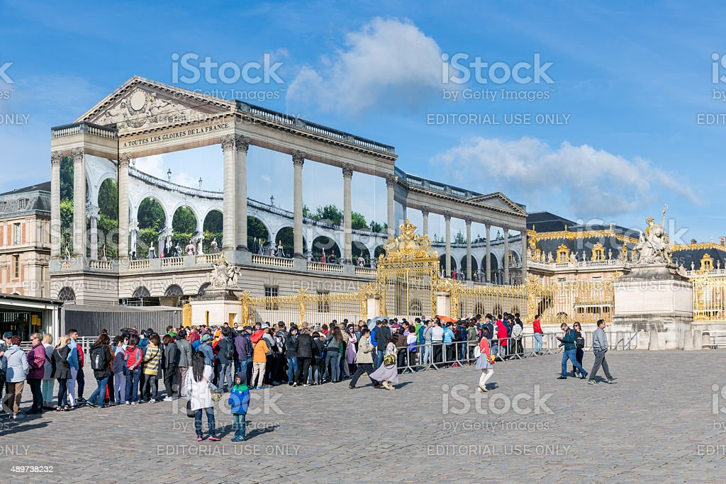 Visitors waiting to visit the Palace of Versailles, Paris, France stock photo