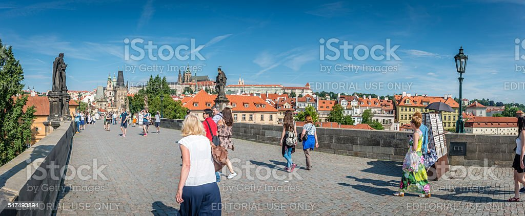 Visitors walk on the famous Charles Bridge stock photo