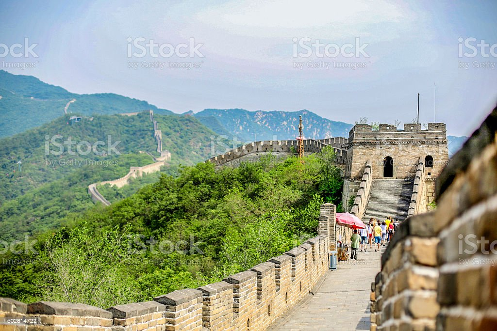 Visitors walk the Great Wall of China in Summer stock photo
