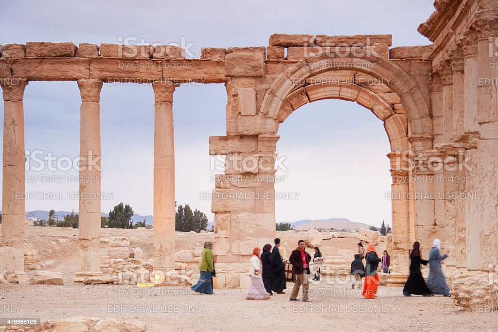 Visitors walking in the ancient city of Palmyra, Syria stock photo