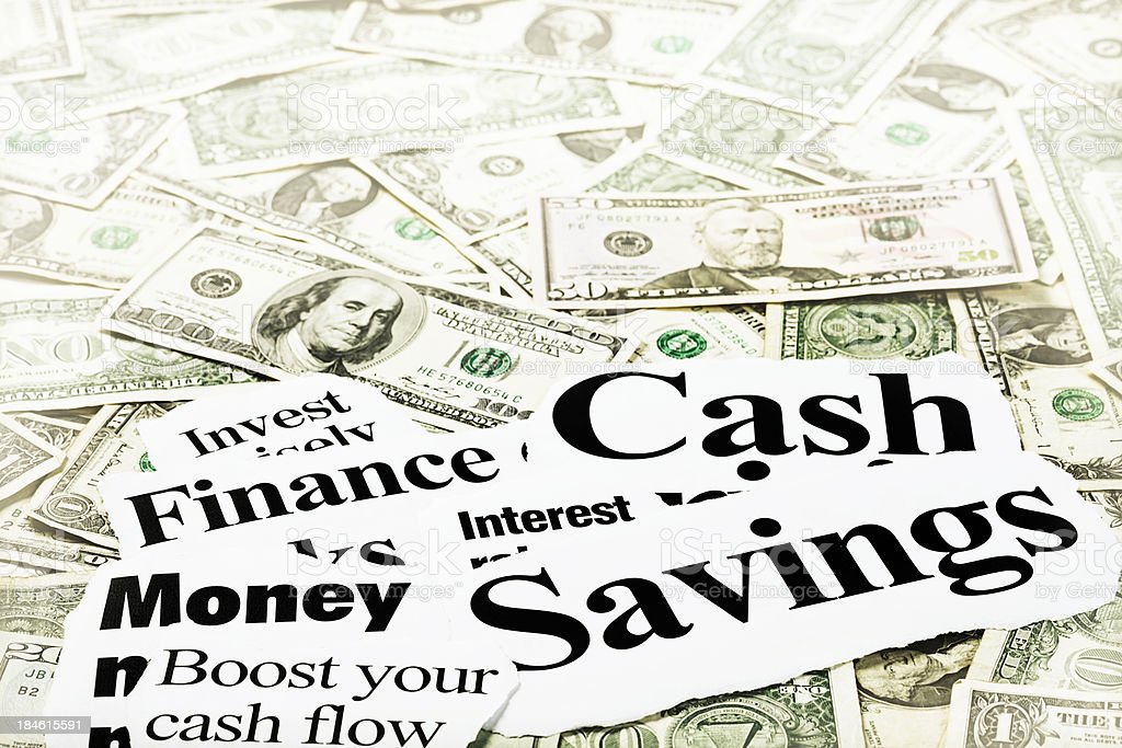Vista of money-related newspaper headlines on US dollar background royalty-free stock photo