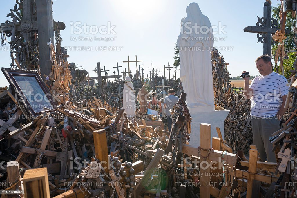 Vistitors at the HIll of Crosses in Lithuania stock photo