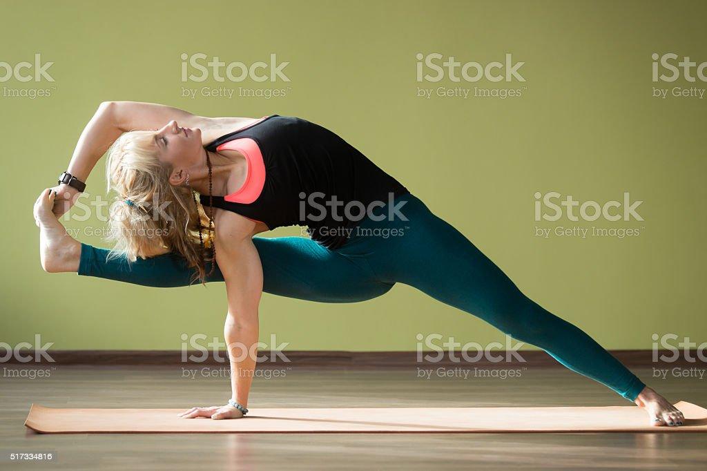 Visvamitrasana yoga Pose stock photo