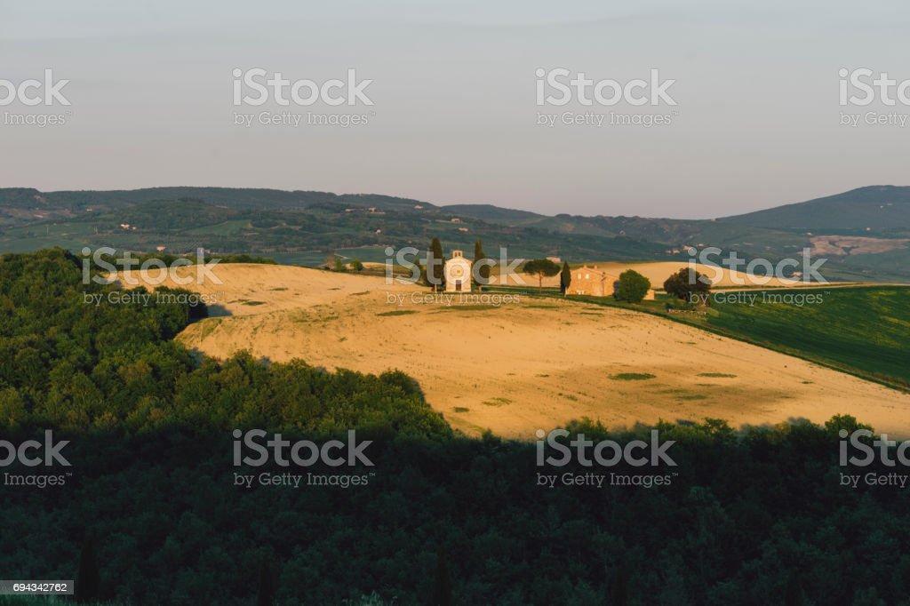Vitaleta chapel in Tuscany at sunset stock photo