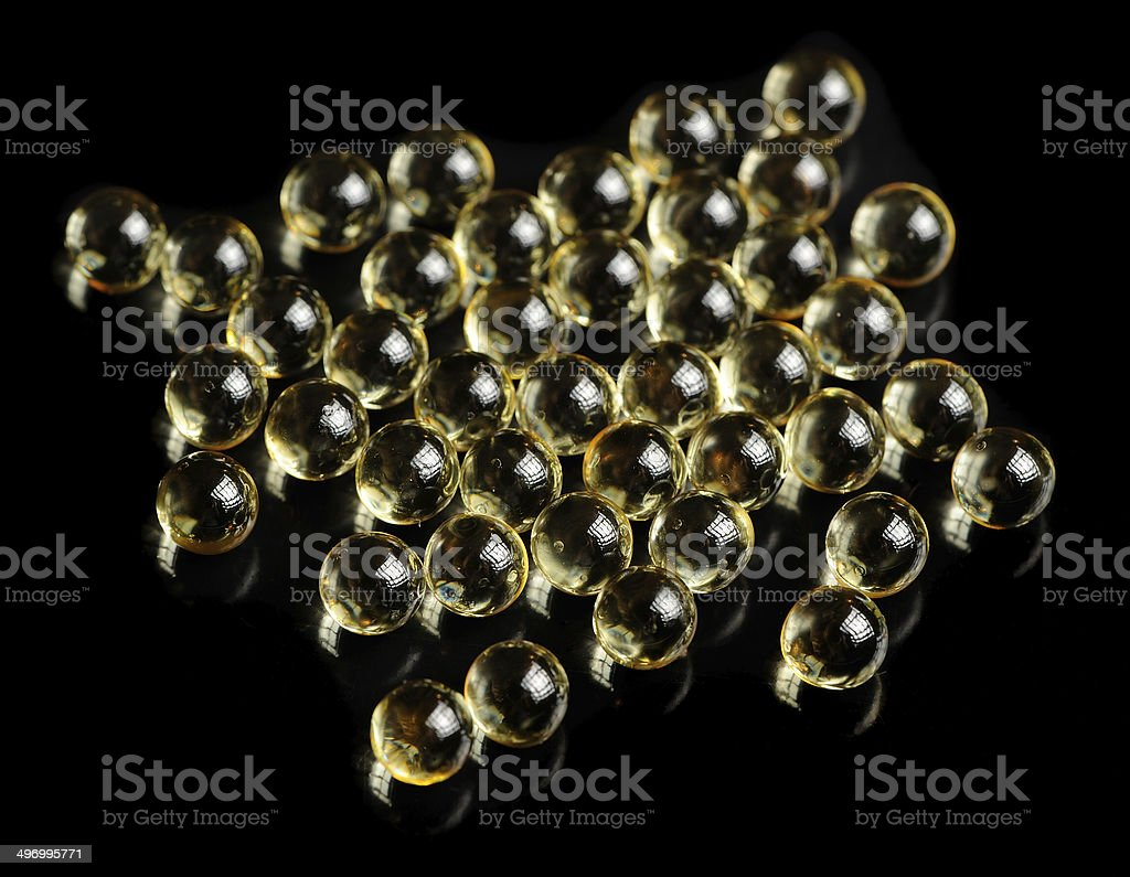Vitamin A (Retinol) Oil Capsules on Black Background royalty-free stock photo