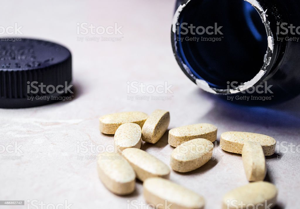 Vitamin and Mineral Pills/Tablets with Bottle Side View royalty-free stock photo
