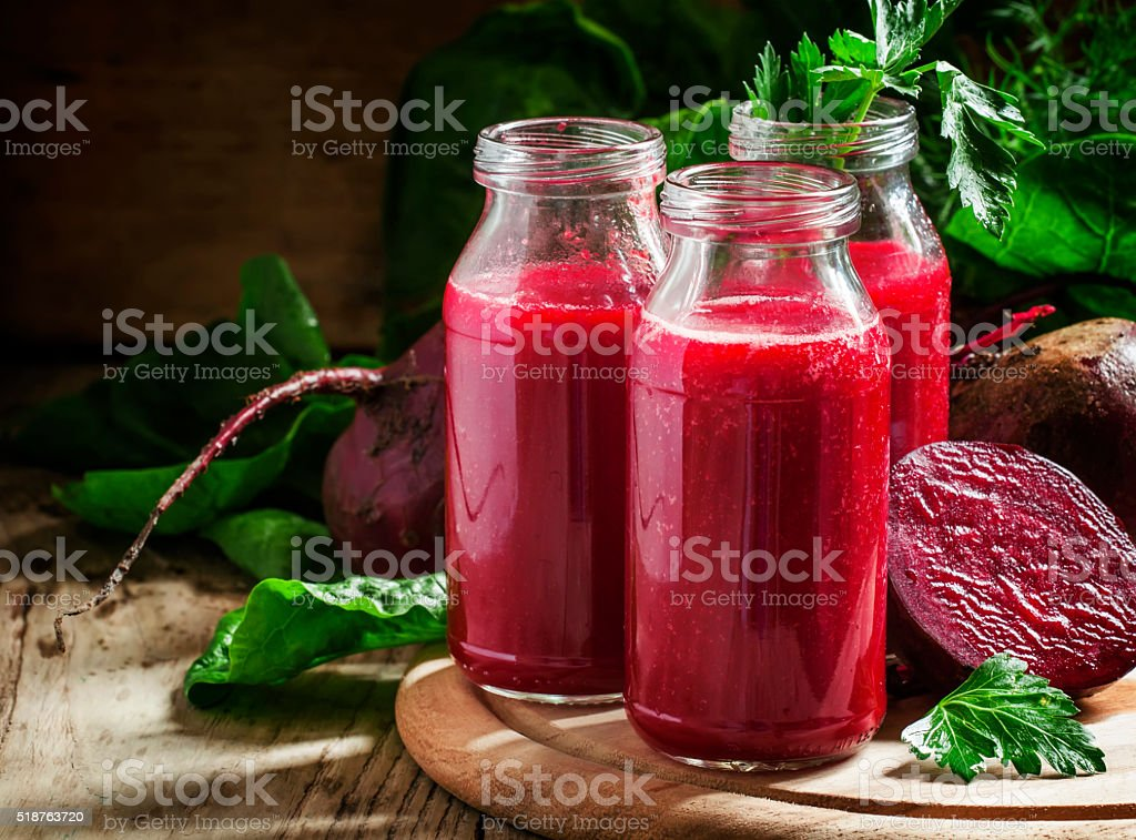 Vitamin beetroot smoothie in glass bottles stock photo