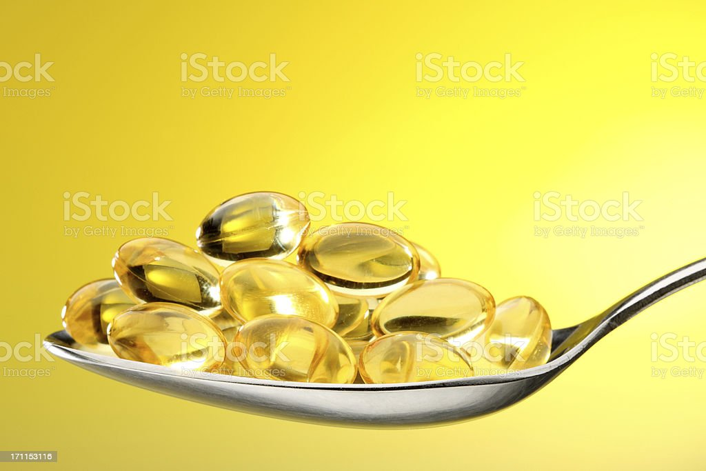 Vitamin capsules in fish oil gel royalty-free stock photo