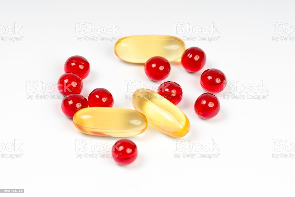 vitamin e and cod liver oil capsules stock photo