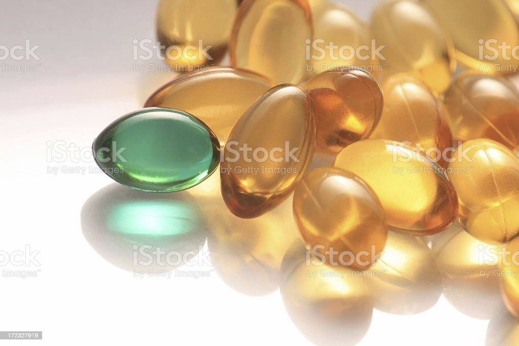 Vitamin E and green Gel Capsules royalty-free stock photo