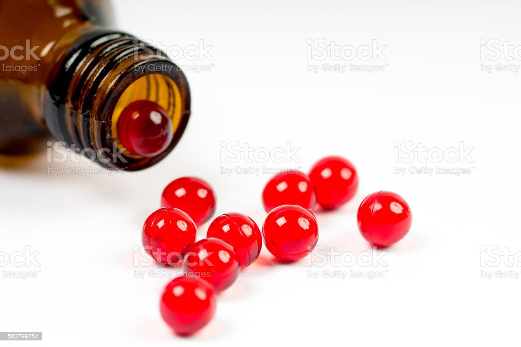 vitamin e capsules with opened bottle stock photo