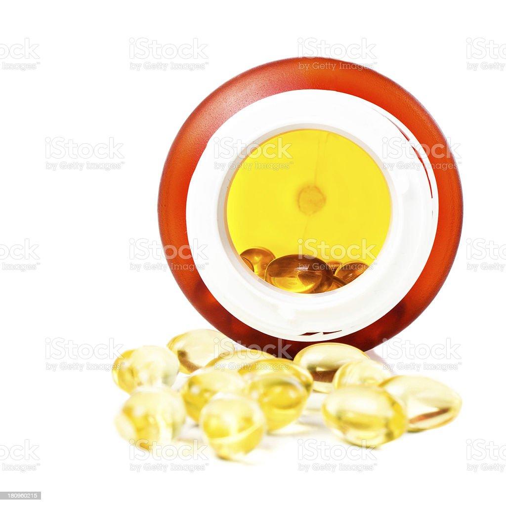 vitamin E omega 3 fish oil capsules  bottle isolated royalty-free stock photo