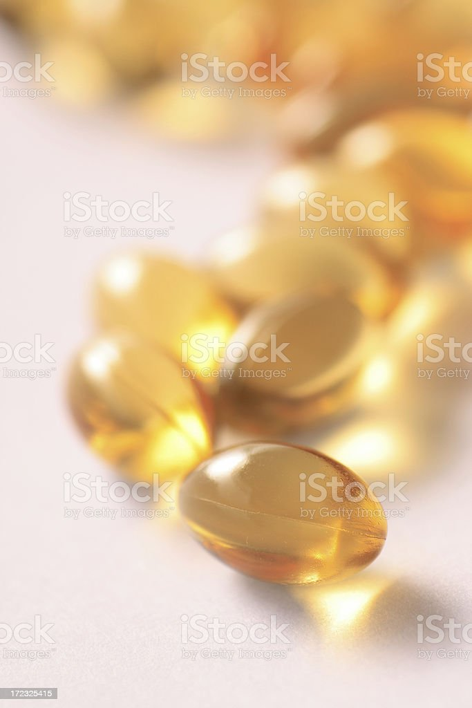 Vitamin E supplement gel capsules royalty-free stock photo