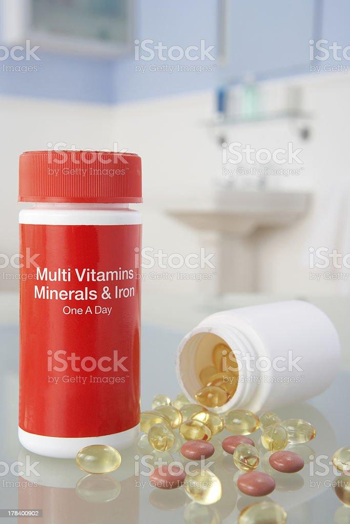 Vitamin pills on bathroom shelf royalty-free stock photo