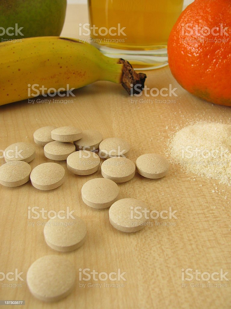 Vitamin powder and tablets stock photo