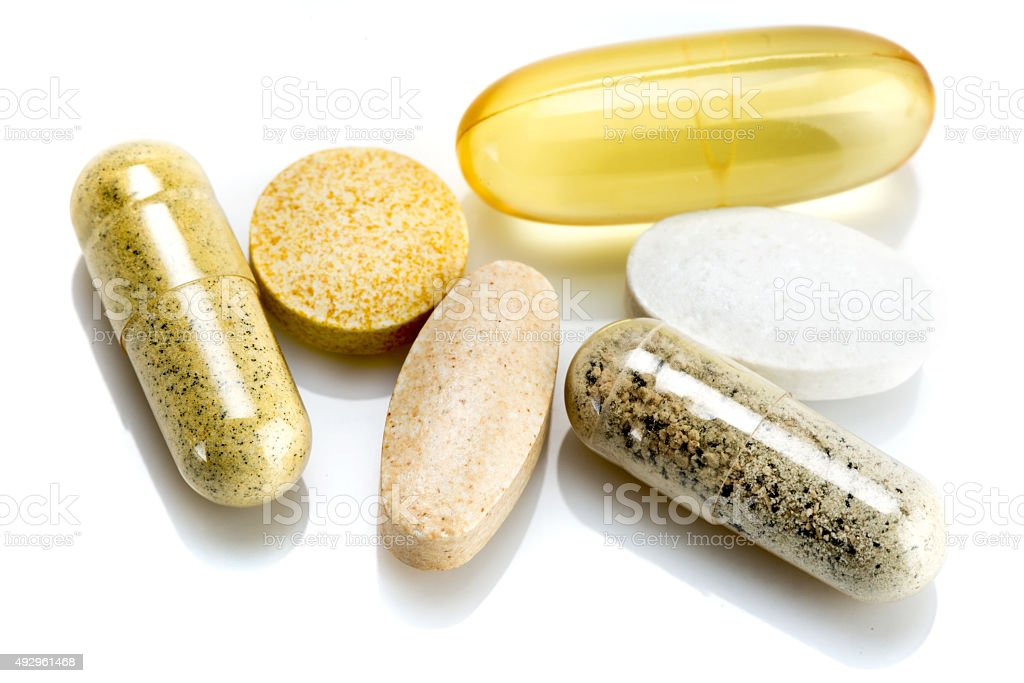 Vitamin supplements - capsules and pills stock photo