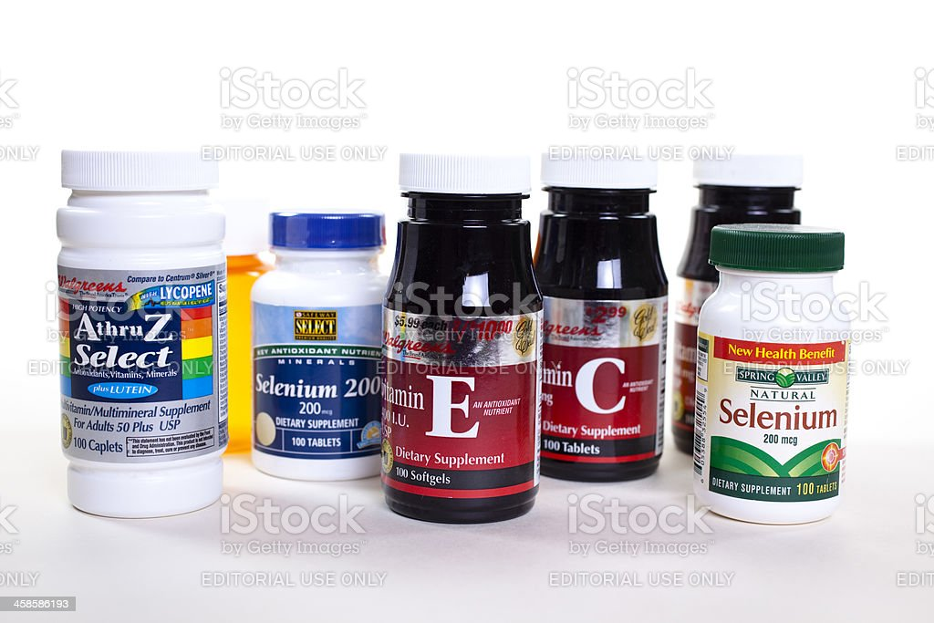 Vitamin supplements in bottles on white background. royalty-free stock photo