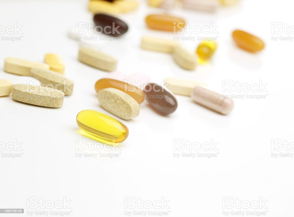 Vitamin supplements on white stock photo