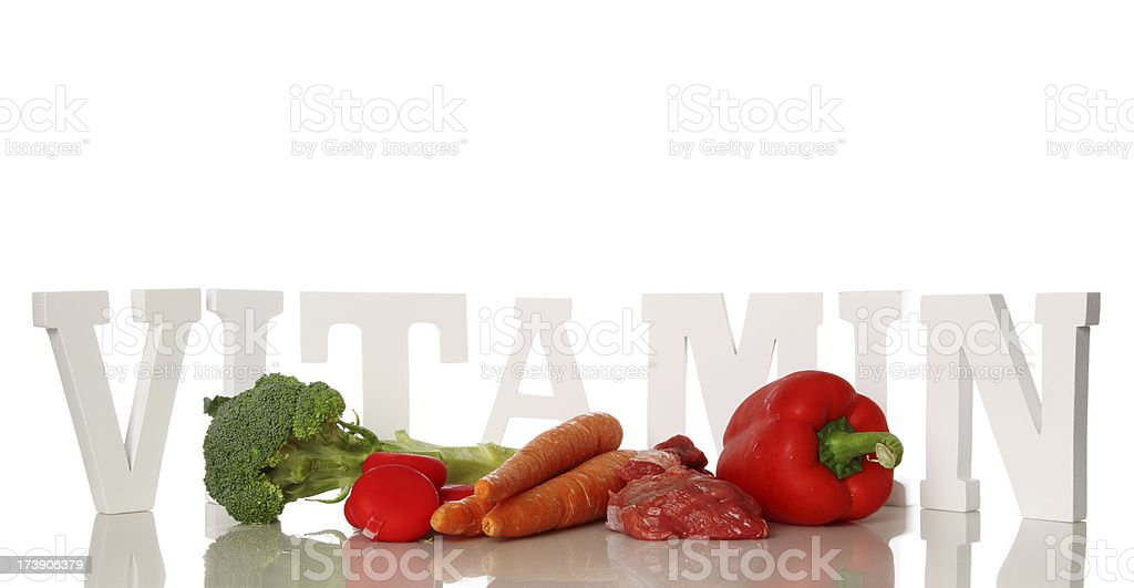 Vitamin word and food royalty-free stock photo