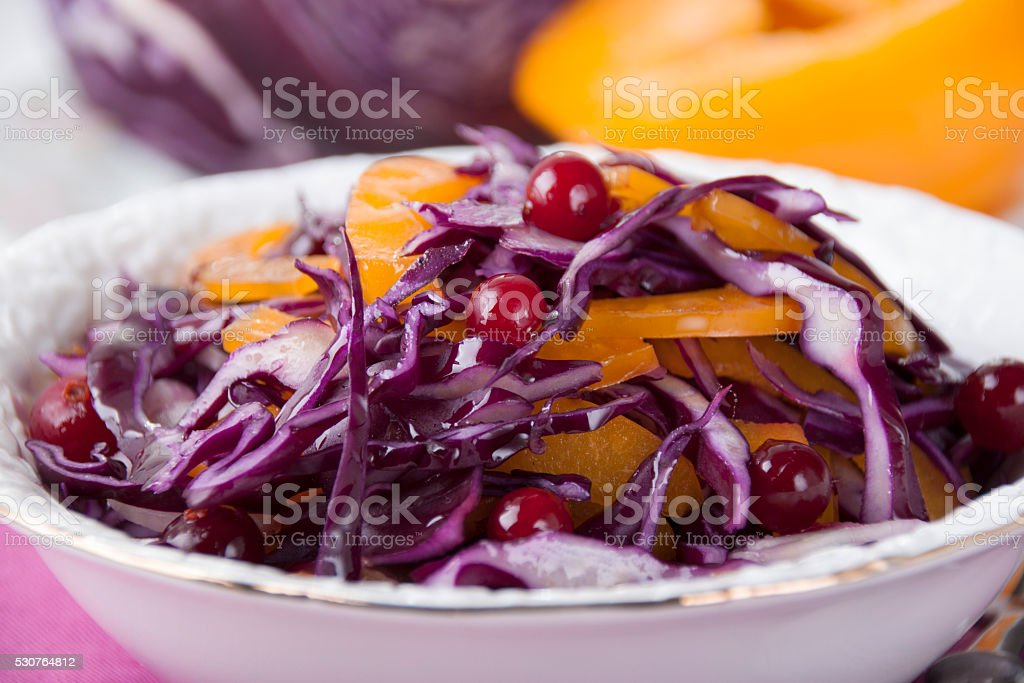 Vitaminic salad of red cabbage, yellow peppers and cranberries. stock photo