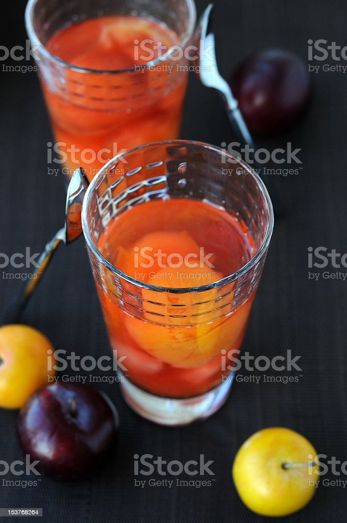 Vitaminized plum drink and plums stock photo