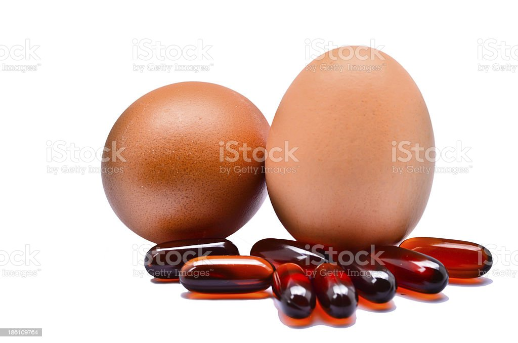 Vitamins and eggs stock photo