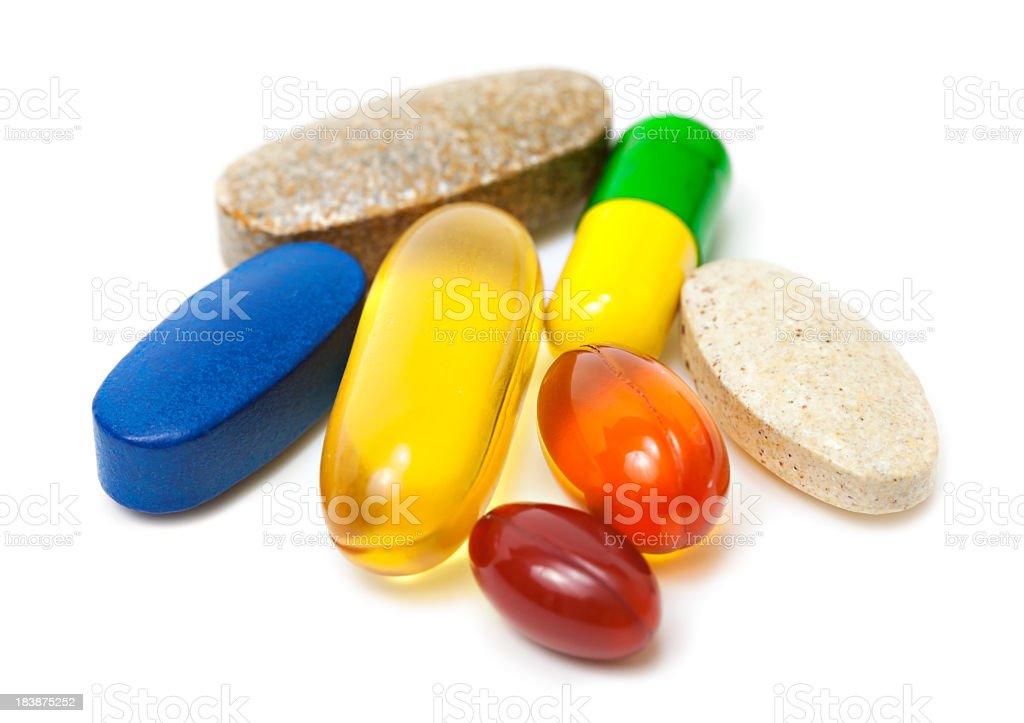 Vitamins and pills stock photo