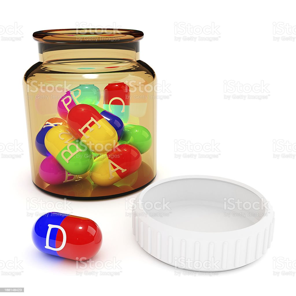 Vitamins in capsules from the bottle royalty-free stock photo